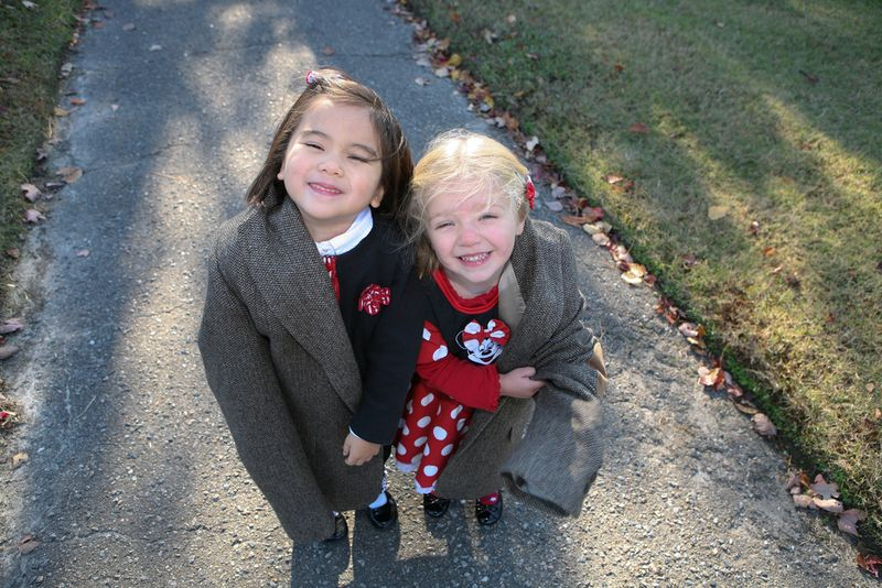 Girls with Daddy's coat